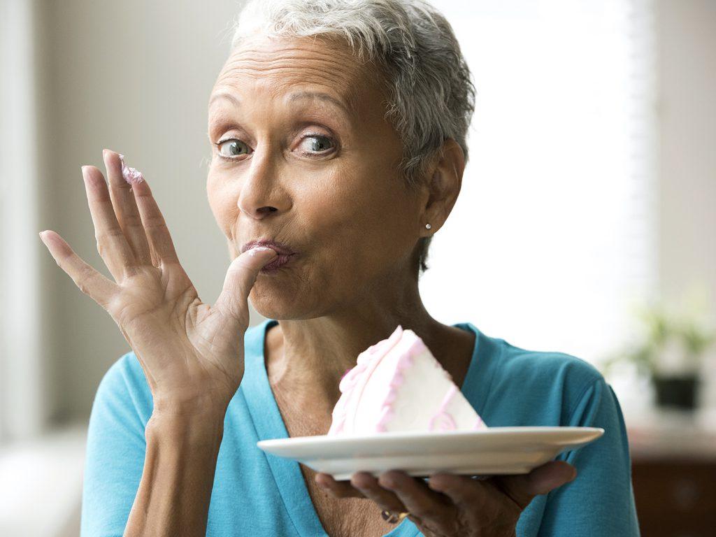 woman enjoying cake