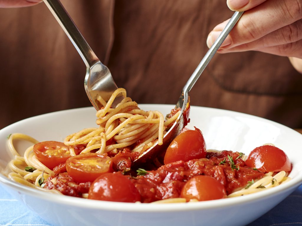 bowl of spaghetti with tomatoes